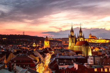 Amazing cityscape view of Prague Castle and church of our Lady Tyn, Czech Republic during sunset time. View from powder tower. World famous landmarks in Europe.