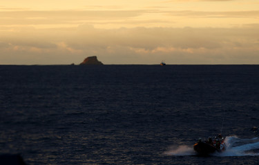An inflatable boat is seen near the Maltese island Filfla, Malta
