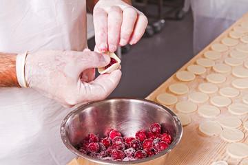 human hands mold cherry dumplings handwork