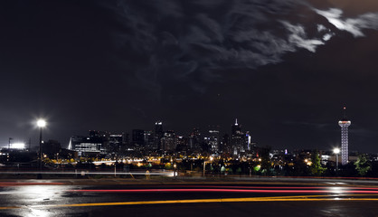 Dark night view of the downtown Denver Colorado skyline with colorful night lights