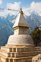 Buddhist stupa with prayer flags in front of the mount Kongde Ri