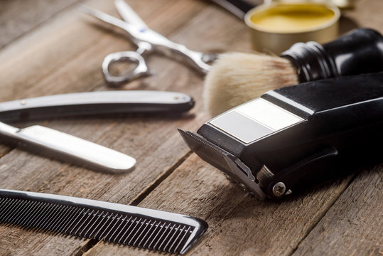 Hair trimmer on wooden surface