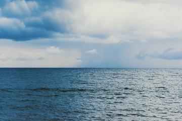 Fotobehang - Winter sea under a cloudy sky