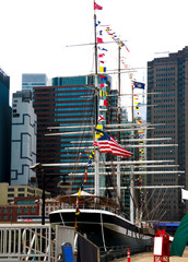 South Street Seaport and Pier 17 in Lower Manhattan. The area includes modern tourist malls featuring food, shopping and nightlife, with a view of the Brooklyn Bridge.
