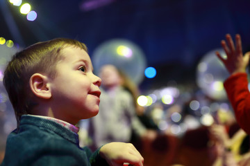 Smiling child in concert hall