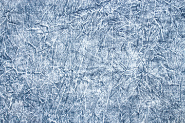 The texture of faded denim jeans.Background of boiled denim.