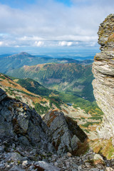 rocky Tatra mountain tourist hiking trails under blue sky in Slovakia