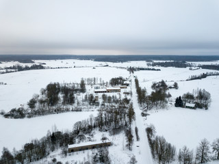 country roads in winter and small village from above