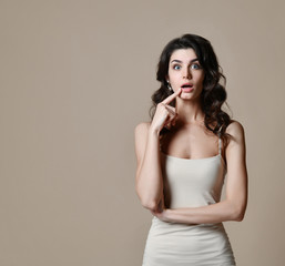 Portrait of surprised brunette girl, keeps mouth wide opened