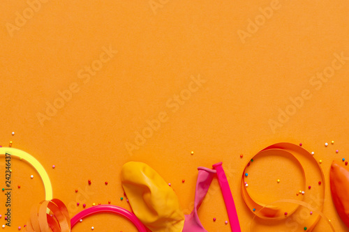 Bright Yellow Background Decorated With Festive Accessories