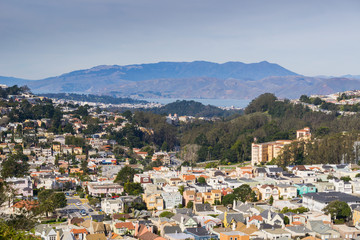 Aerial views of residential areas of San Francisco, Marin county and the bay in the background, California