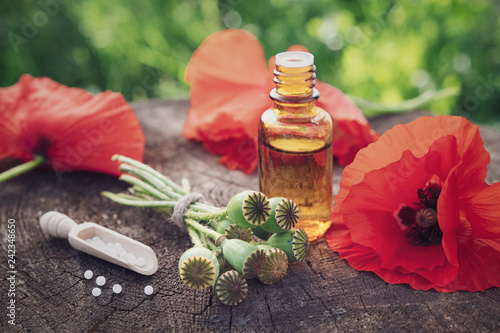 Poppies Poppy Flower Heads Bottle Of Infusion And Scoop Of