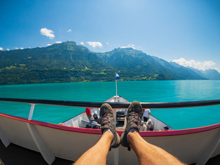POV travelling by boat at Brienz lake at summer time in Switzerland.