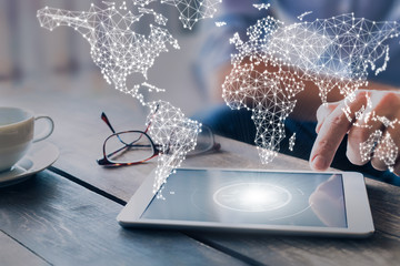International business network with connected lines, worldwide communication for internet of things, finance, trading, blockchain and web technologies, concept wit businessman using tablet computer