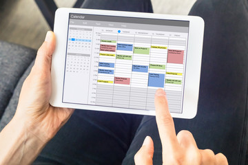 Calendar app on tablet computer with planning of the week with appointments, events, tasks, and...