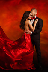 Couple Fashion Portrait, Elegant Man in Suit and Dancing Woman in Red Dress