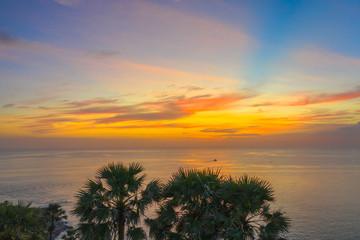 sunset above sugar palm around Promthep cape viewpoint Phuket Thailand