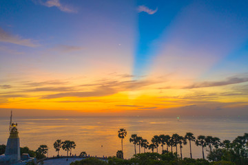 sunset above the great lighthouse at Promthep cape Phuket Thailand