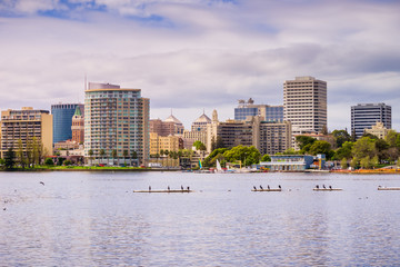 Downtown Oakland as seen from across Lake Merritt on a cloudy spring day, San Francisco bay area, California Wall mural