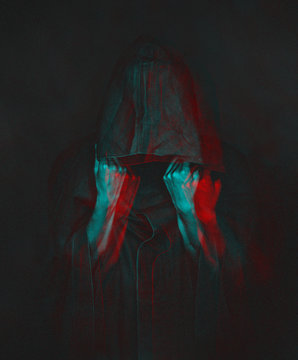 Anaglyph effect of human in black coat with a hood.