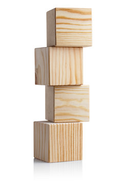 Tower of four wooden cubes, isolated on white background