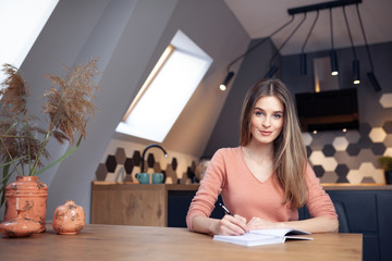 Beautiful young smiling woman working from home
