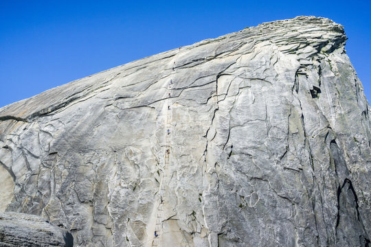 Going up on the Half Dome cables on a sunny summer day, Yosemite National Park, California