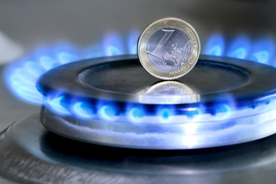 Burning natural gas and one euro coin on gas hob