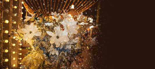 Bouquet of flowers on the street at night it snows. Holiday decoration of the city. Place for your text.