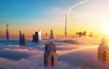 Foto auf AluDibond Stadtgebaude Dubai sunset view of downtown covered with clouds