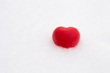White red heart in snow. Valentine's day and love concept. Copy space for text.