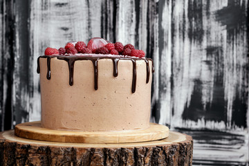Chocolate cake with mirror glaze with raspberries. Picture for recipe or confectionery catalog.