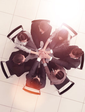 top view.a team of like-minded people sitting in a circle
