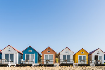 Colored beach houses in a row