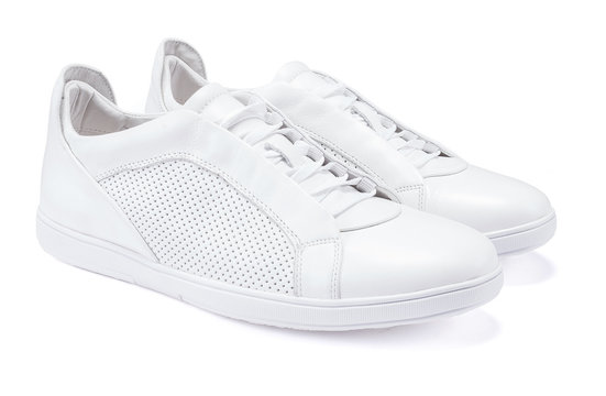 Pair of new white sneakers on white background