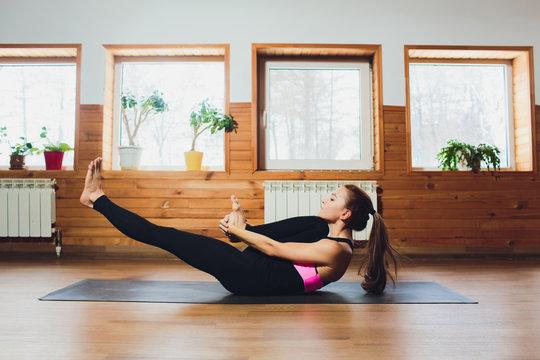 Yoga series: young woman in Pavanamuktasana yoga Pavanamuktasana, Wind Relieving Pose, Wind Removing Pose or Wind Liberating Pose is an asana.