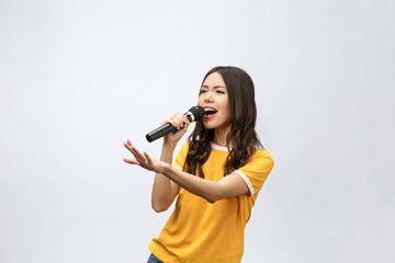 beautiful stylish woman singing karaoke isolated over white background. Fotobehang