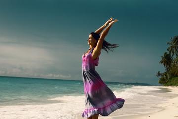 Brunette girl having fun on tropical beach