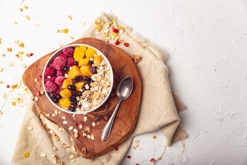 Raspberries, Mango and blueberries in a Bowl. Healthy breakfast concept with yoghurt