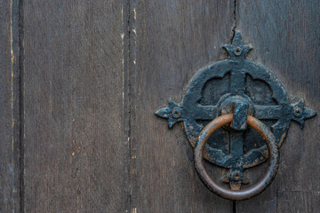 Vintage black door panels with ancient knocker - high quality texture / background