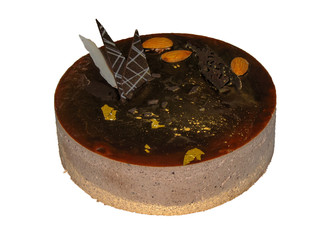 chocolate cake covered with chocolate mousse and decorated with almonds and gold,