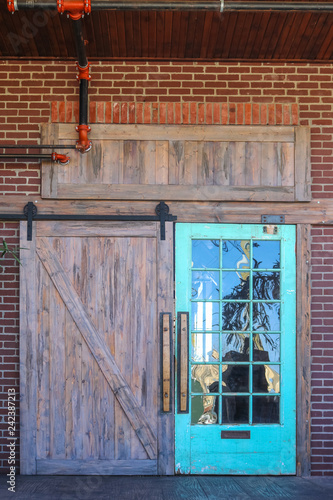 Unique Rustic Barn Door Entrance To Building With Reflection