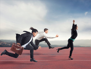 Businesswoman wins a run contest against the competitors. Concept of success