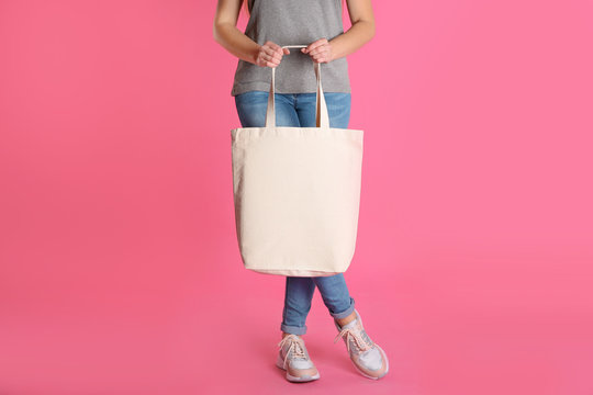 Woman with eco bag on color background. Mock up for design