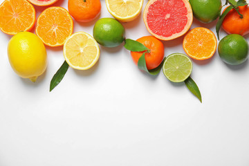Different citrus fruits on white background, top view. Space for text Fototapete
