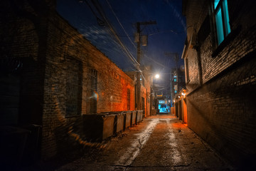 Wall Mural - Dark and eerie industrial urban city alley with dumpsters at night in Chicago