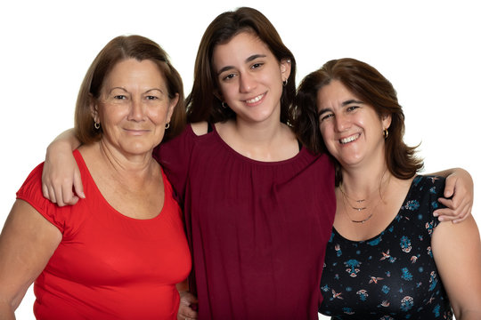 Three generations of latin women smiling and hugging - On a white background