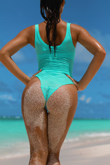 Sandy woman buttocks  on summer beach, Vacation at Paradise travel concept. Tropical background with colorful water. Sexy woman body covered with White sand, blue sky and crystal sea