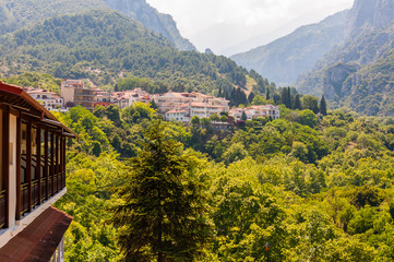Popular touristic panoramic viewpoint on Mount Olympus from below from Litochoro town with its cozy hotels, apartments, scenic cityscape views and forest surroundings