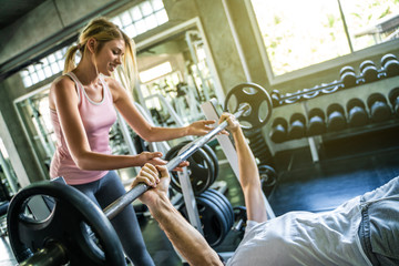 Healthy lifestyle couple exercise weight training sport in gym